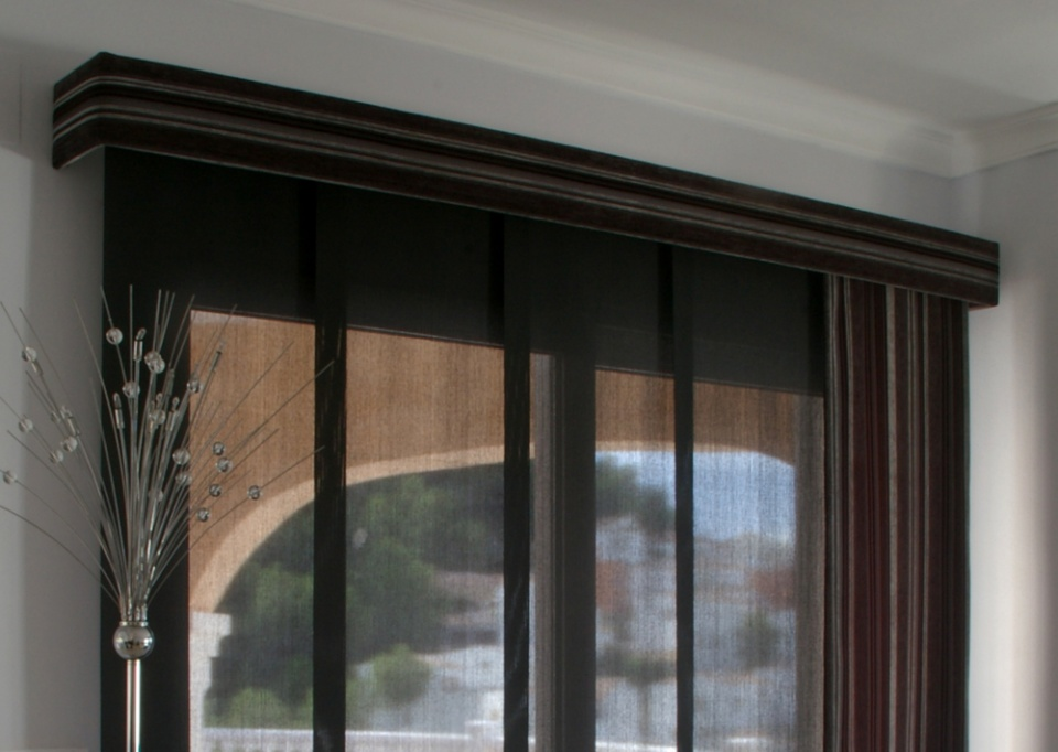 Track Panel System: polyscreen panels with fabric front panel and upholstered pelmet