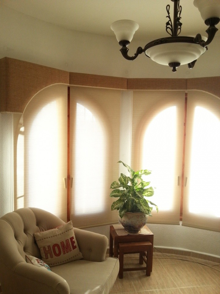 Upholstered Pelmets: shaped to follow the arc of the windows