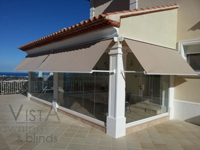 Cased Drop Arms Awning mounted on Pergola _ Alcalali